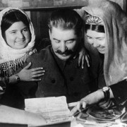 Joseph Stalin with two young women collective farm workers from Tadjikistan Soviet Republic at a conference of cotton farm workers. January 1936. USSR.