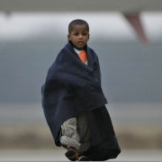 A Haitian child walks to a bus after arriving at a military airport in Eindhoven, Netherlands, along with 105 other children from Haiti, aged 6 months to 7 years, on Thursday Jan. 21, 2010, (AP Photo/Peter Dejong).